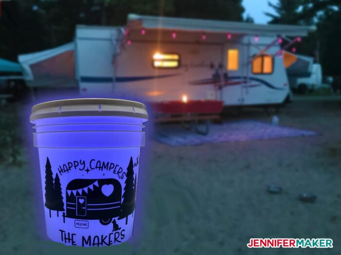 Camping Light Bucket at night with a camper