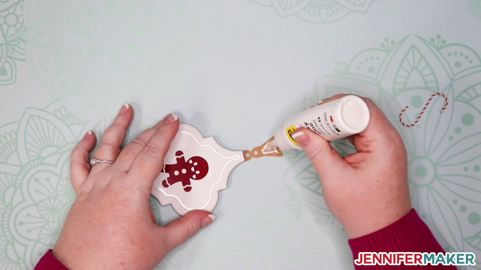 Applying glue to the top of the ornament backing