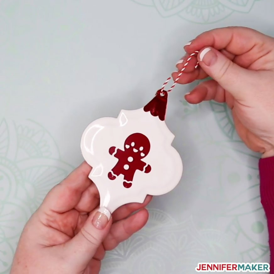 Insert a hanger into the hole at the top of your ceramic tile ornament