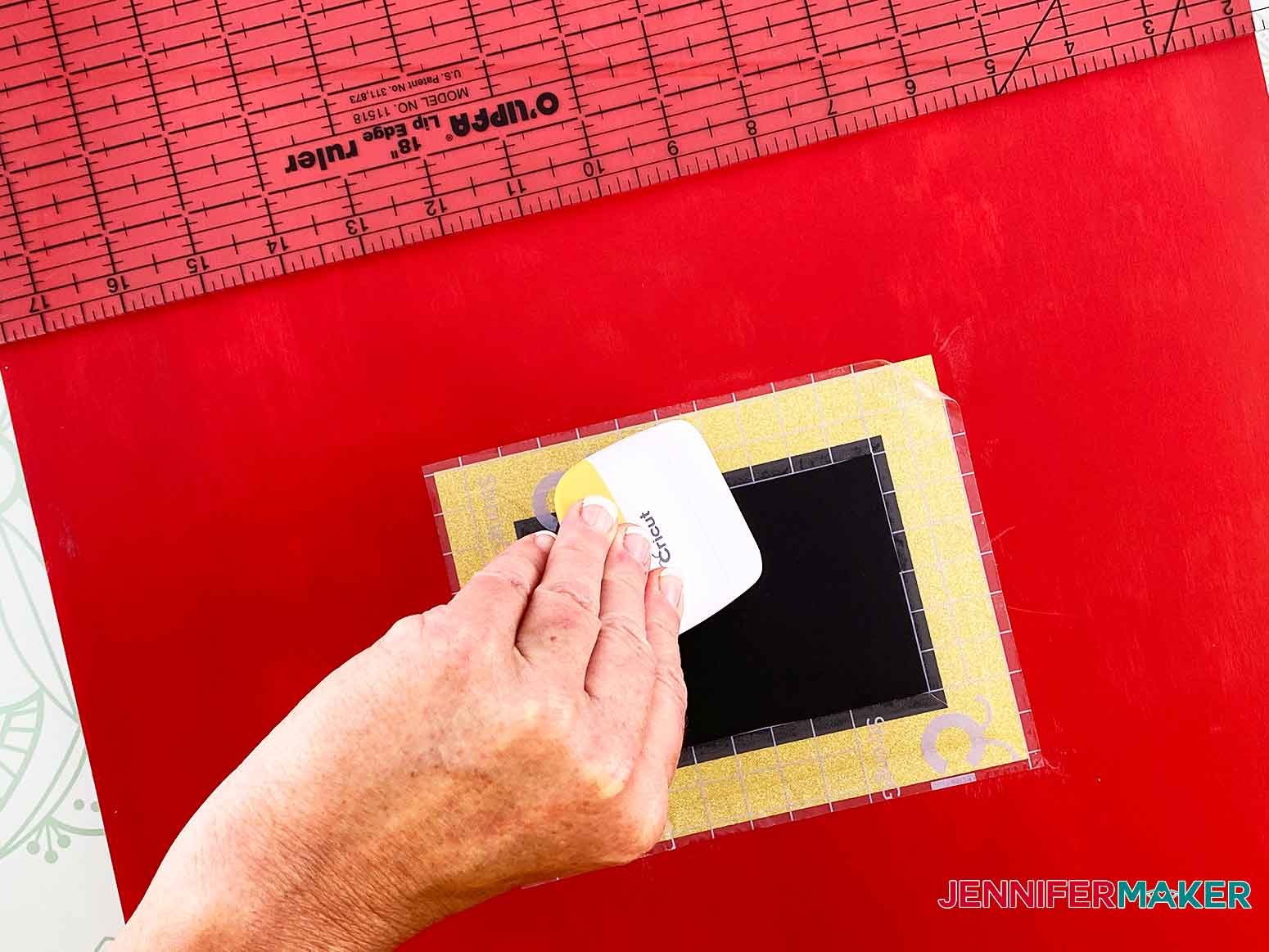 Use your scoring tool to press the vinyl buckle down for my Christmas Countdown sign