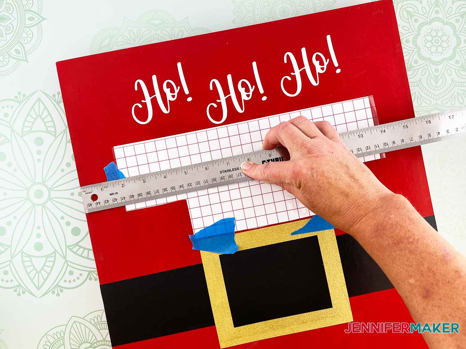 Measure the vinyl lettering placement for the Christmas Countdown Sign