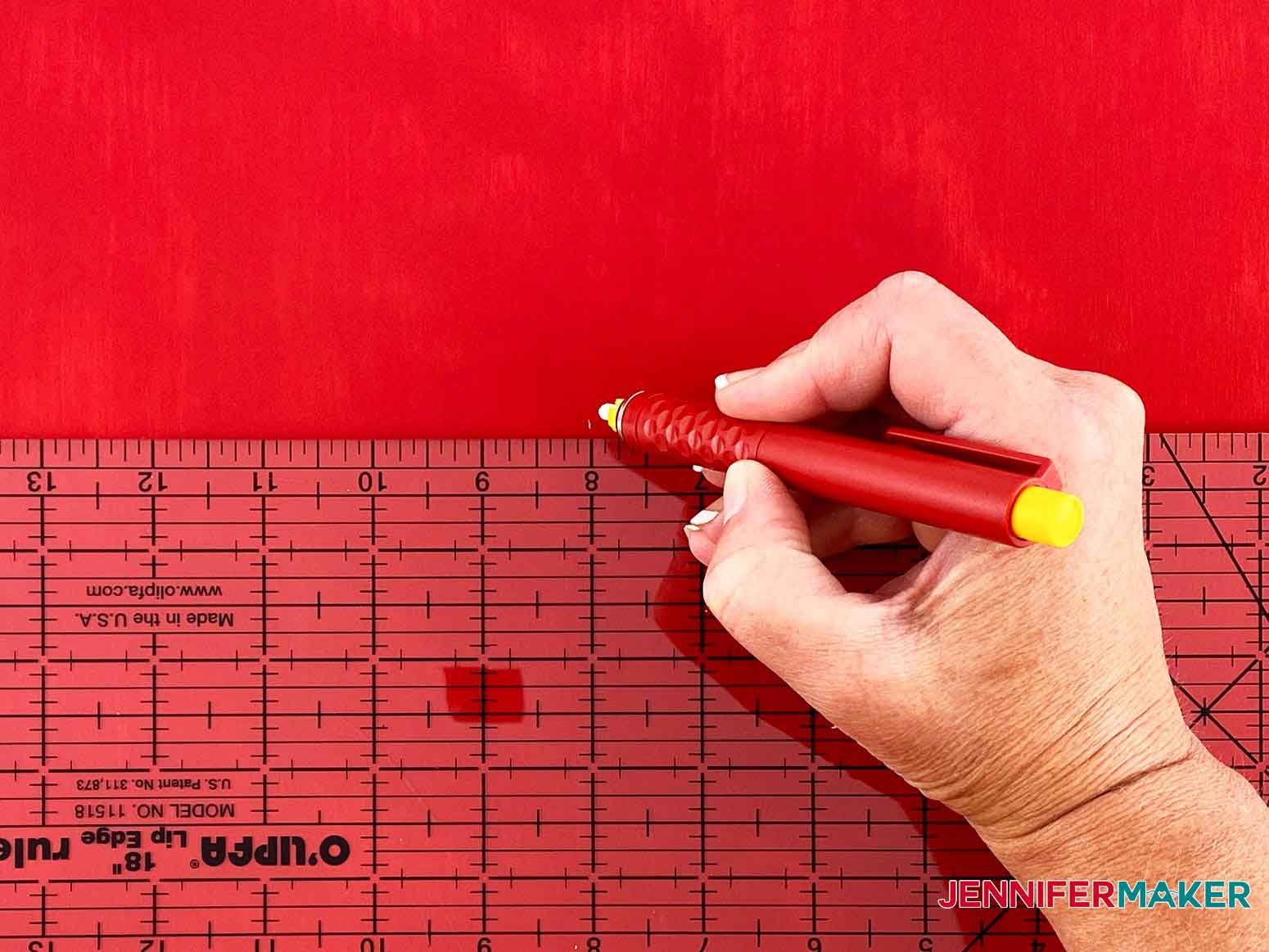 Find the center of the Christmas Countdown sign and mark it using a ruler and pencil
