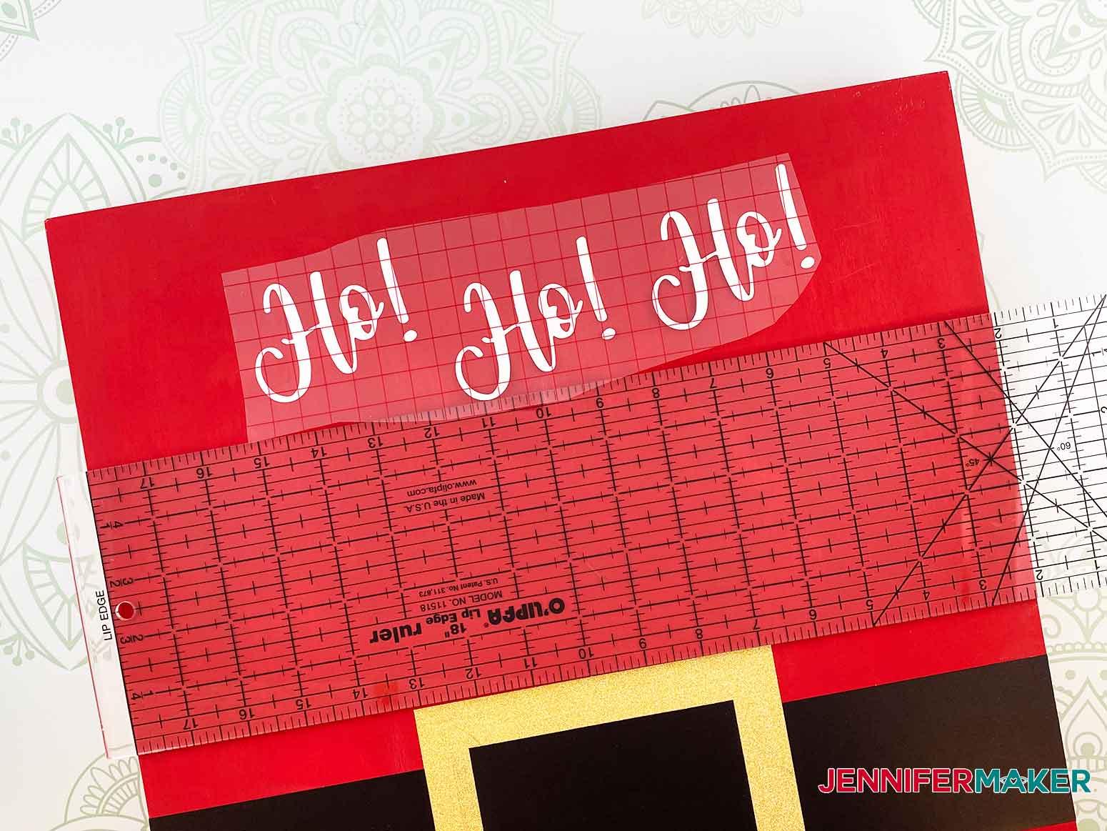 Place Ho! Ho! Ho! vinyl on the Christmas Countdown Sign