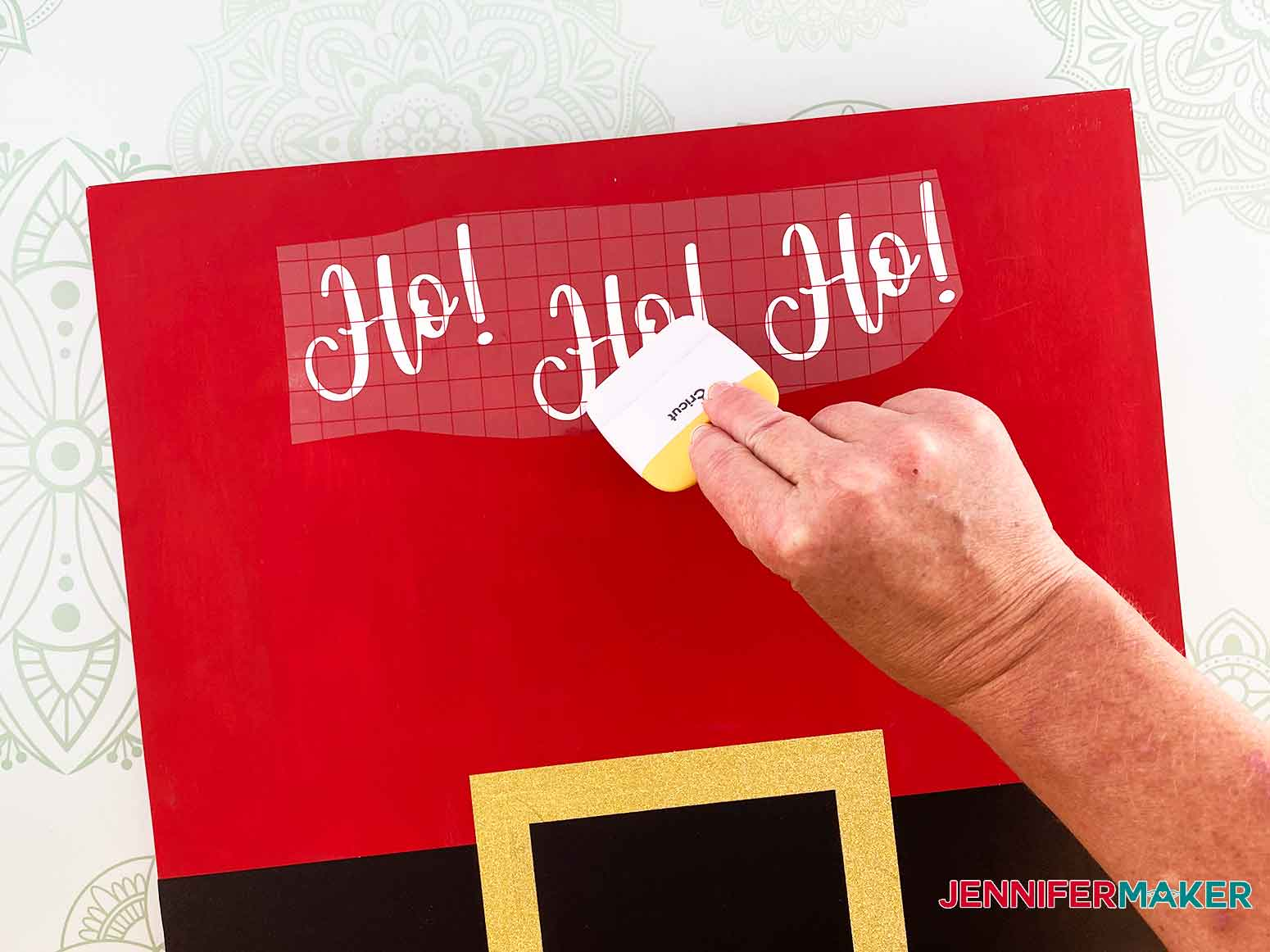 Use your scraping tool to apply Ho! Ho! Ho! to the Christmas Countdown sign