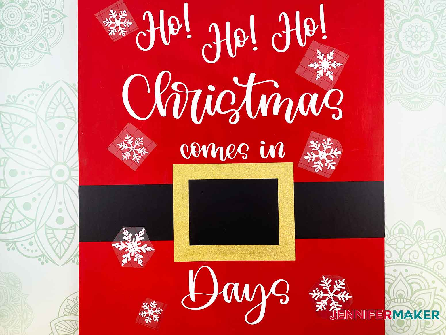 Place the vinyl snowflakes on the Christmas Countdown Sign