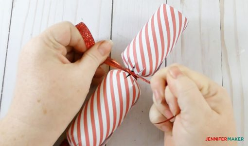 Tying the other end of the Christmas cracker and party popper