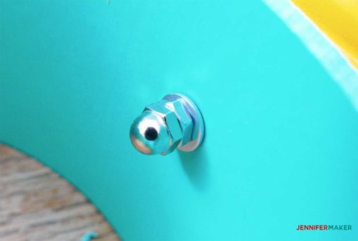 washer and nut on the end of the machine screw in the blue pvc pipe