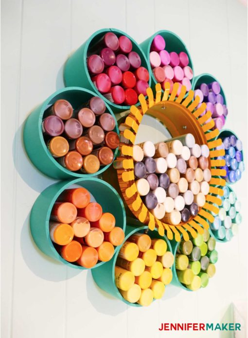 Colorful craft paint storage organizer made from PVC pipes and a duct collar -- click to see the full tutorial! #craftroom #organization #storage