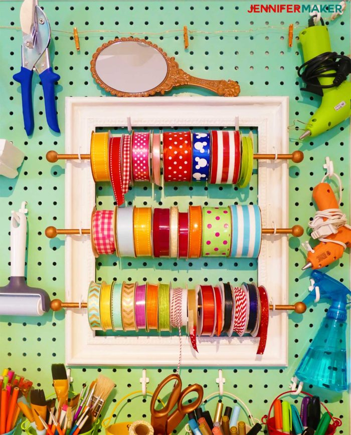 Ribbon storage frame on my giant craft room pegboard