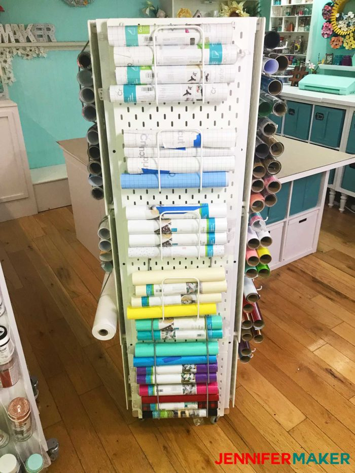 Craft Vinyl Storage showing pegboards with letter holders to hold the rolls