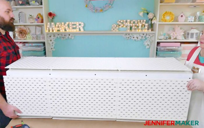 An IKEA Kallax unit covered with Skadis pegboards to create a craft vinyl storage organizer