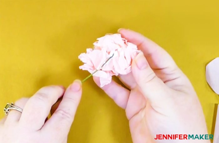 Glue floral wire into the center of a crepe paper ball to to make crepe paper peony flowers