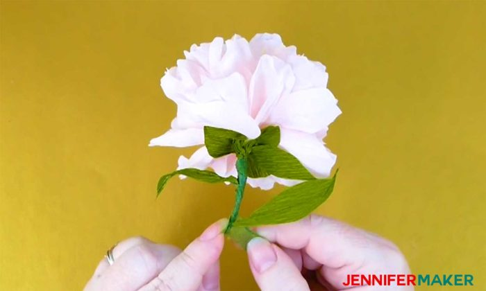 Wrap floral tape around the stem of your crepe paper peony flower