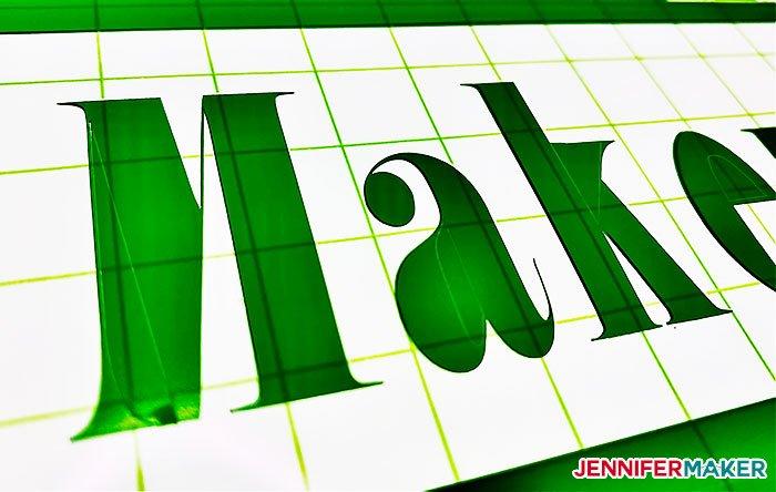 Weeding green vinyl on the Cricut BrightPad Go at maximum brightness