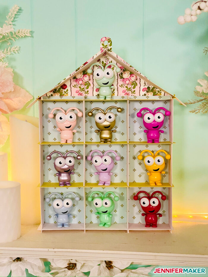 DIY Display Case in the shape of a house holding 10 Cricut Cutie figures