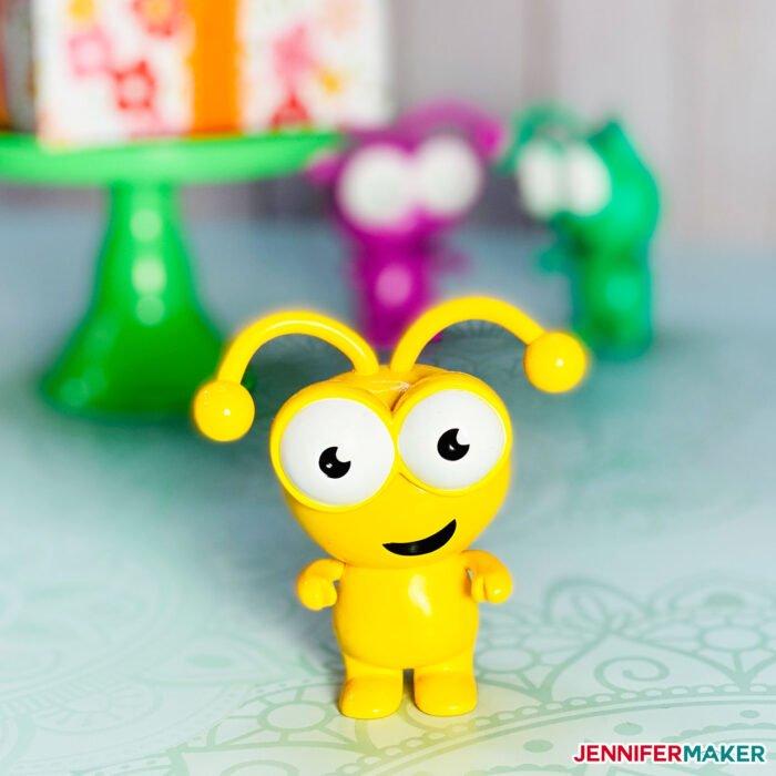A sunflower yellow Cricut Cutie plastic collectible figurine