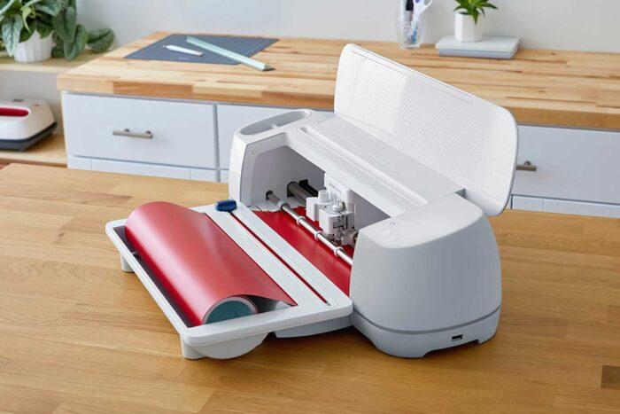 The Cricut Roll Holder on a new Cricut Maker 3 cutting machine
