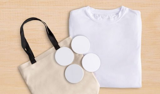 Totebag, round ceramic coasters, and white T-shirt are some of the Cricut Infusible Ink blanks available.