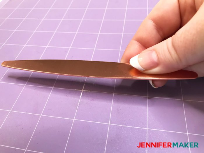 Centering a copper bracelet on a StrongGrip Mat to use the Cricut Maker Engraving Tool