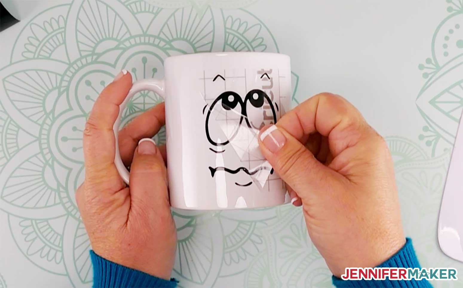 Removing the transfer tape from your vinyl on a Cricut mug
