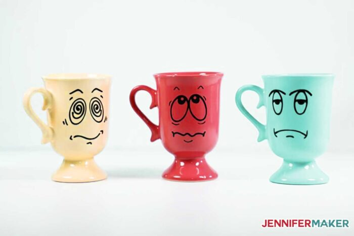 Colorful Cricut mugs with funny faces made with vinyl and mod podge sealer
