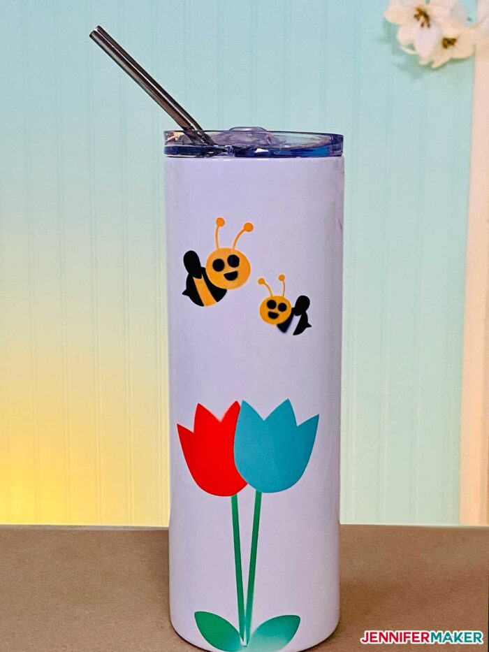 Skinny tumbler made of metal with a white coating and Infusible INk