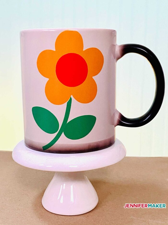 Black color change mug with Infusible Ink flower transferred with the Cricut Mug Press