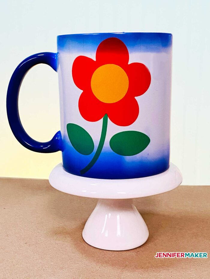 Blue color changing mug made with red and yellow Infusible Ink transferred with the Cricut Mug Press