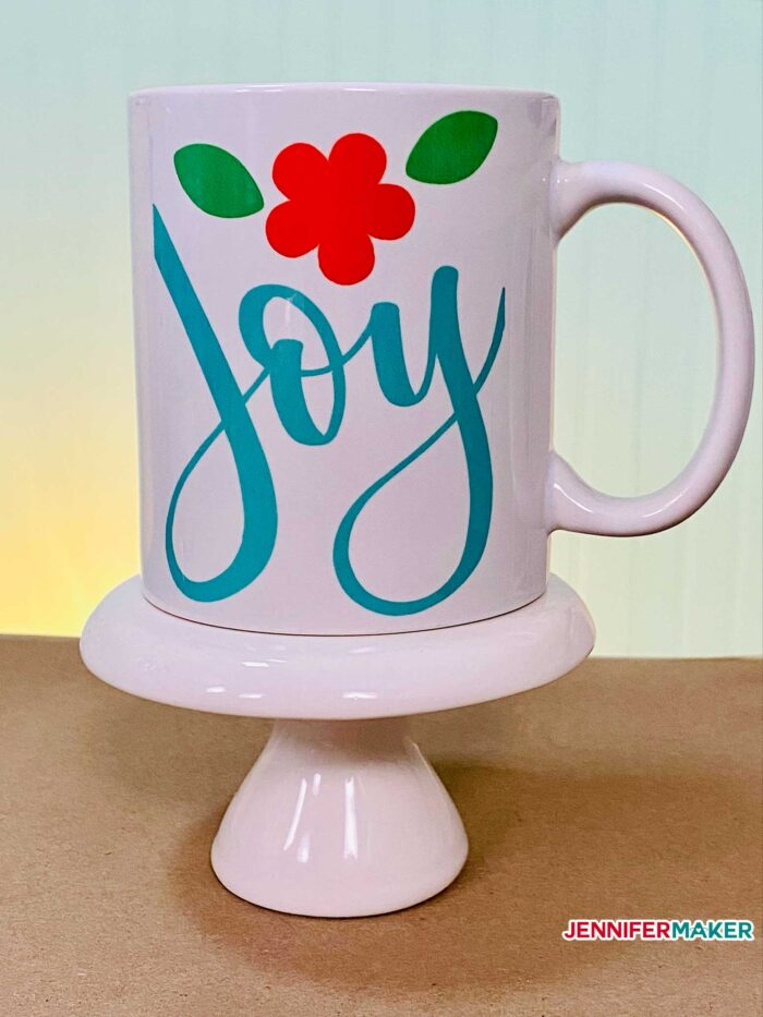 Sublimation blank mug made with blue and red Infusible Ink transfer sheets on the Cricut Mug Press