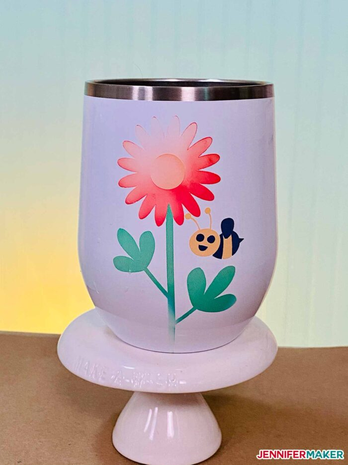 Wine tumbler with Infusible Ink on the Cricut Mug Press