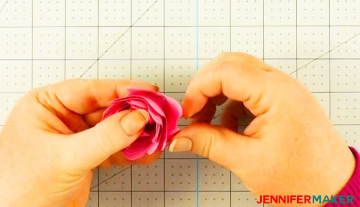 Arrange the petals on the Cricut paper flower as the glue dries