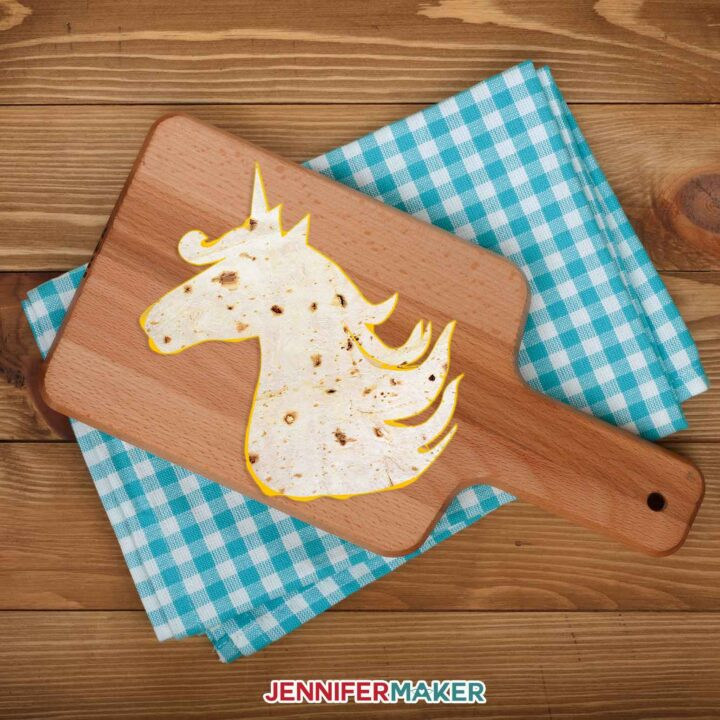 Unicorn shaped tortilla on a wood cutting board makes a Cricut tortilla