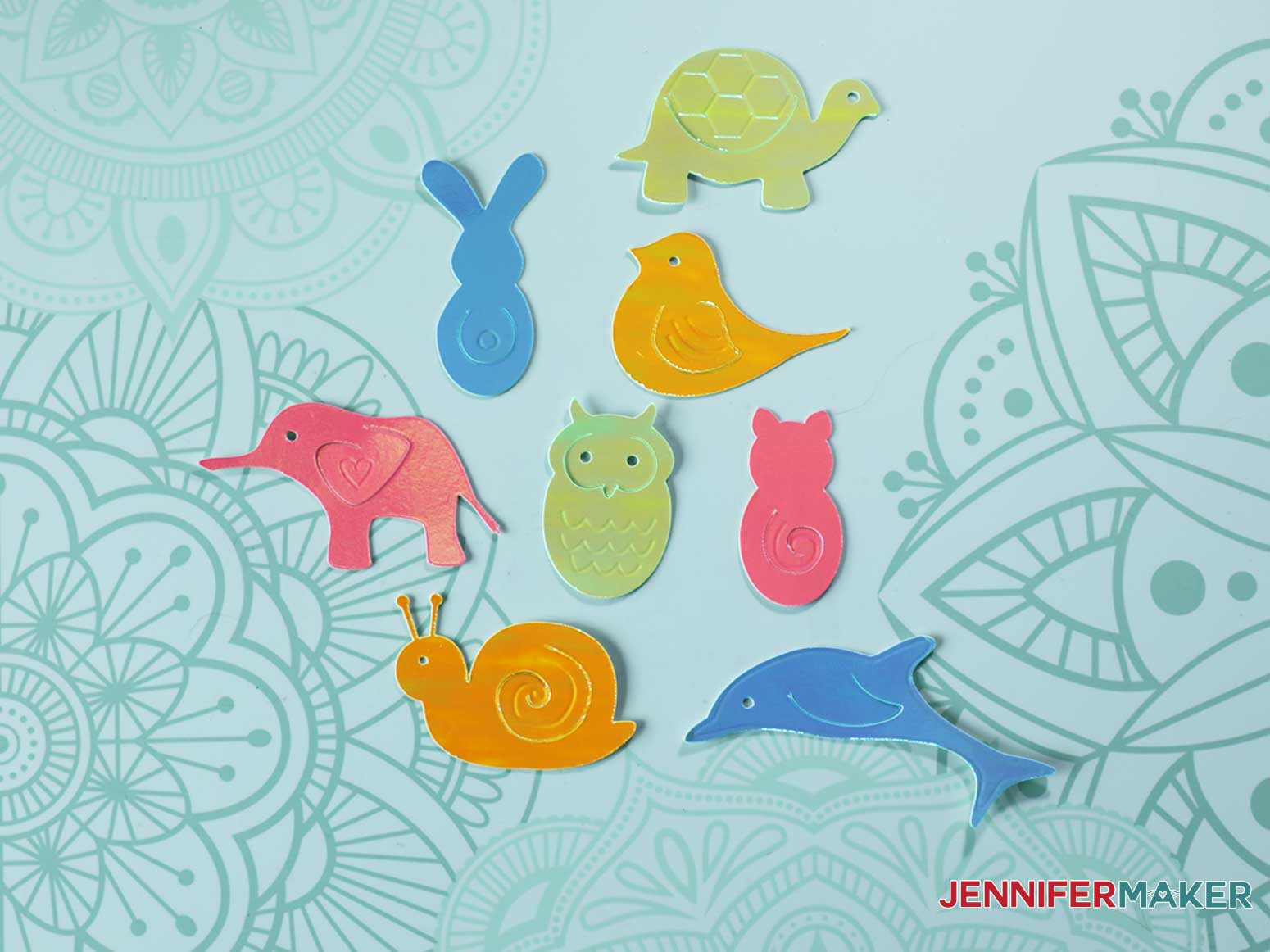 Cute and colorful debossed animal paper clips on a spiral bound book