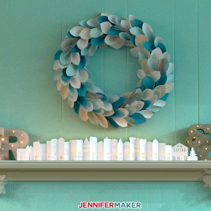 The DIY Christmas Town Countdown on my mantle for holiday decorating