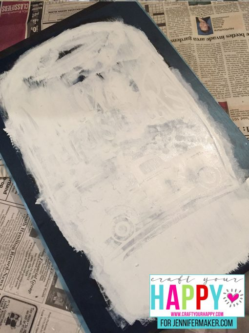 Painting over the stencil for the DIY Christmas Mason Jar Snowglobe Chalkboard Sign