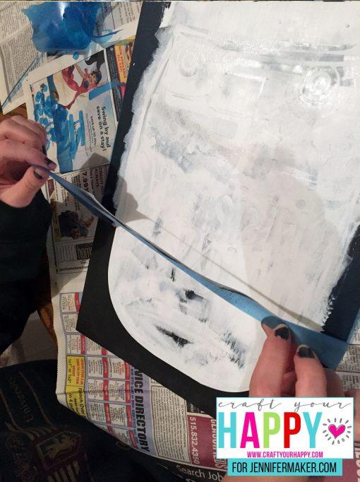 Finishing the painting of the DIY Christmas Mason Jar Snowglobe Chalkboard Sign