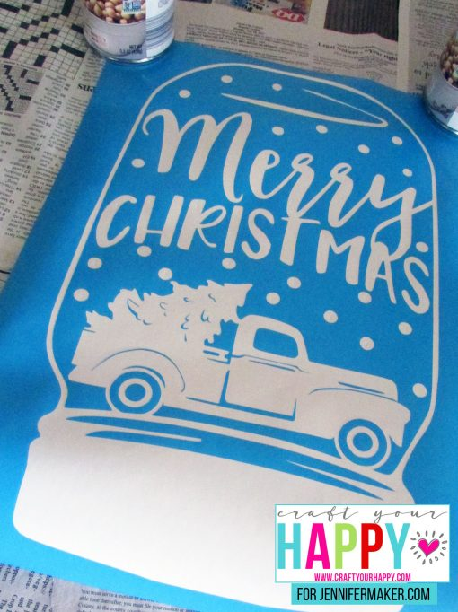 The finished stencil for the DIY Christmas Mason Jar Snowglobe Chalkboard Sign