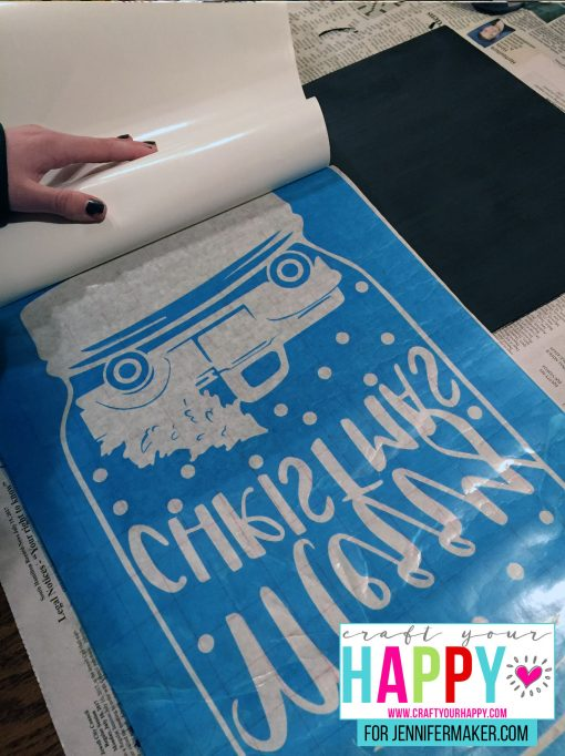 Peeling off the backing of the Oramask for the DIY Christmas Mason Jar Snowglobe Chalkboard Sign