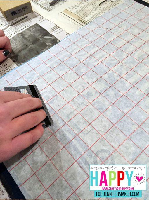 Applying the stencil to the DIY Christmas Mason Jar Snowglobe Chalkboard Sign