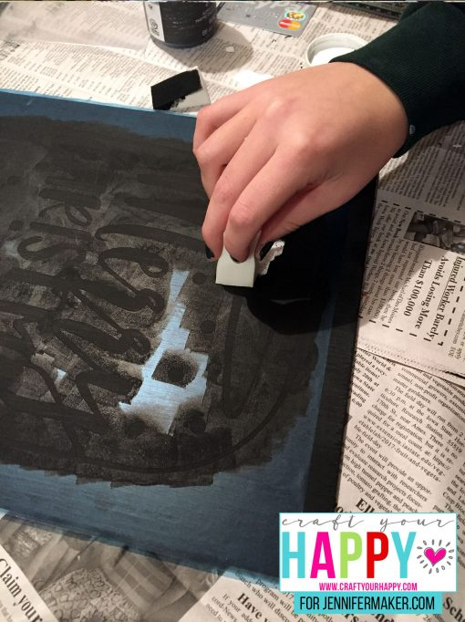 Sponging the stencil for the DIY Christmas Mason Jar Snowglobe Chalkboard Sign