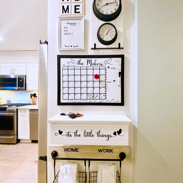 Black & white Family Command Center on a white kitchen wall