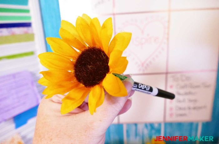A whiteboard pen with a silk sunflower taped to it to go with my DIY Command Center
