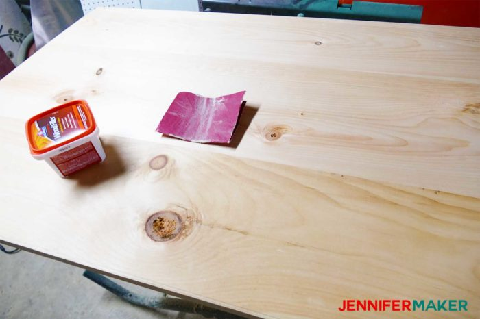 Sanding and filling the planks for the DIY Command Center with Paper Storage Shutters