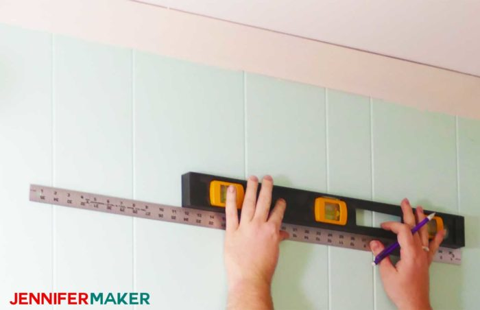 Measure and mark your wall, using a level, before installing the DIY copper pipe curtain rods