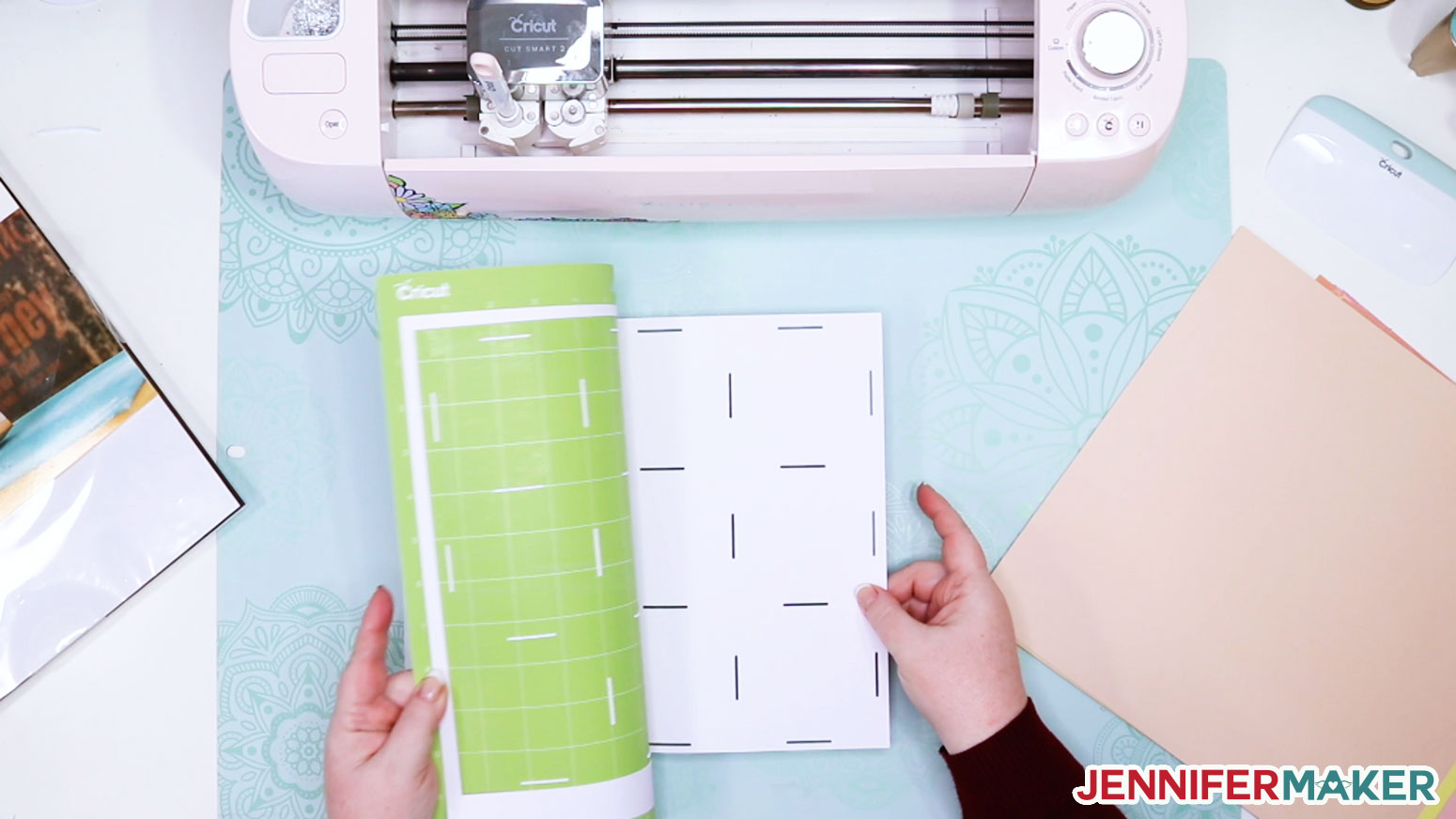 Removing the Kraft board from the green Cricut cutting mat