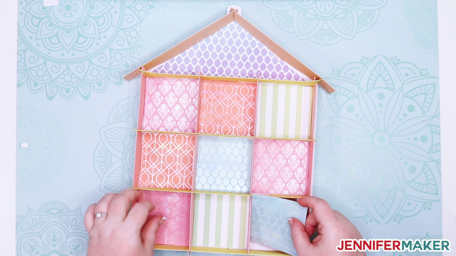Placing the wallpaper in each room of the house-shaped display case