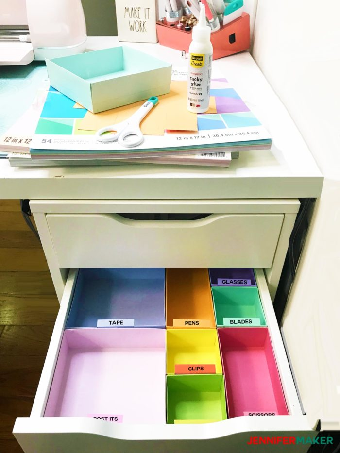 Labels on colorful boxes creating DIY drawer dividers to organize a drawer