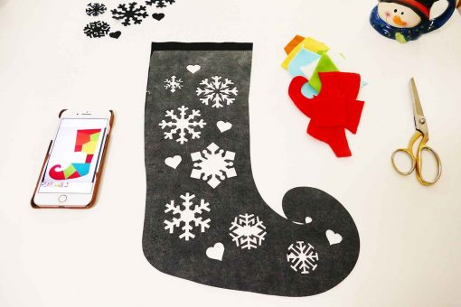 Remove the backing from the Wonder-Under that is on the back of your DIY elf stocking