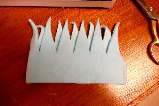 Sew the edge of the fringe top to form a tube