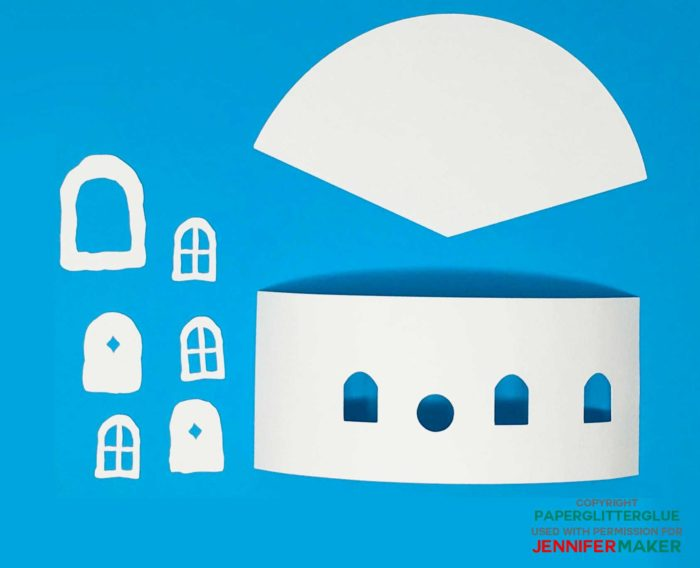 Cut paper pieces needed to make the DIY fairy house with a flower roof